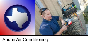 Austin, Texas - an HVAC contractor servicing an air conditioner