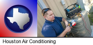 Houston, Texas - an HVAC contractor servicing an air conditioner