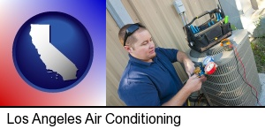 Los Angeles, California - an HVAC contractor servicing an air conditioner