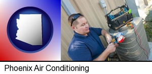 Phoenix, Arizona - an HVAC contractor servicing an air conditioner