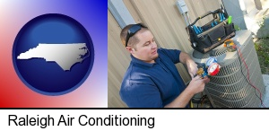 Raleigh, North Carolina - an HVAC contractor servicing an air conditioner