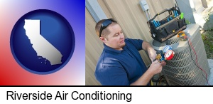 Riverside, California - an HVAC contractor servicing an air conditioner