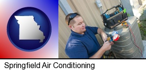 Springfield, Missouri - an HVAC contractor servicing an air conditioner