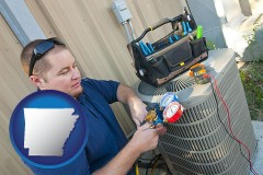 arkansas an HVAC contractor servicing an air conditioner