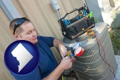 washington-dc an HVAC contractor servicing an air conditioner