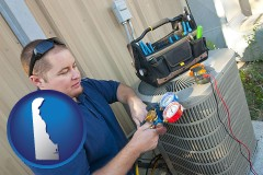 delaware map icon and an HVAC contractor servicing an air conditioner