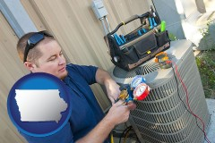 iowa an HVAC contractor servicing an air conditioner