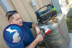 michigan HVAC contractor servicing an air conditioner
