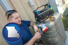 missouri an HVAC contractor servicing an air conditioner