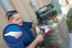 north-carolina an HVAC contractor servicing an air conditioner