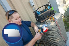 nebraska an HVAC contractor servicing an air conditioner