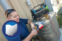 ohio HVAC contractor servicing an air conditioner