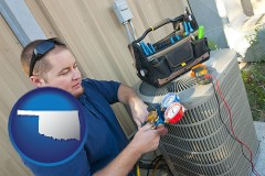 oklahoma HVAC contractor servicing an air conditioner