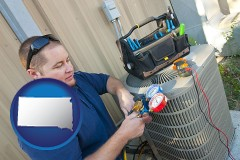 south-dakota HVAC contractor servicing an air conditioner
