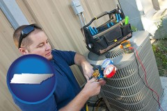 tennessee map icon and an HVAC contractor servicing an air conditioner