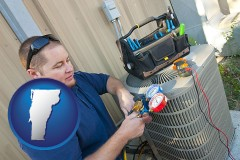 vermont an HVAC contractor servicing an air conditioner
