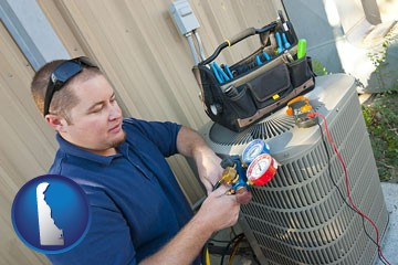 an HVAC contractor servicing an air conditioner - with Delaware icon