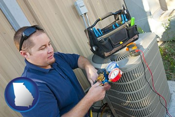 an HVAC contractor servicing an air conditioner - with Georgia icon