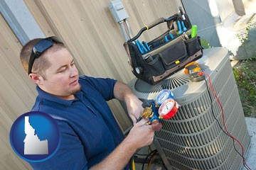 an HVAC contractor servicing an air conditioner - with Idaho icon