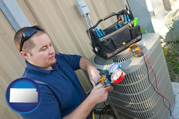 an HVAC contractor servicing an air conditioner - with Kansas icon