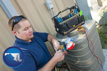 an HVAC contractor servicing an air conditioner - with Maryland icon