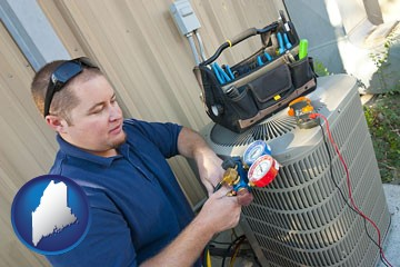 an HVAC contractor servicing an air conditioner - with Maine icon