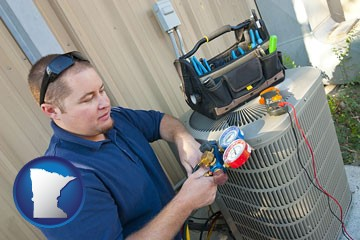 an HVAC contractor servicing an air conditioner - with Minnesota icon