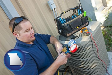 an HVAC contractor servicing an air conditioner - with Missouri icon