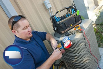an HVAC contractor servicing an air conditioner - with Nebraska icon