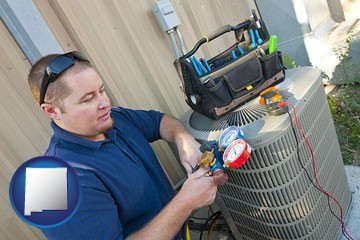 an HVAC contractor servicing an air conditioner - with New Mexico icon